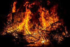 Sparks and tongues of fire on branches and trunks burning in a b. Ig bonfire Royalty Free Stock Photos