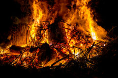 Sparks and tongues of fire on branches and trunks burning in a b Royalty Free Stock Image