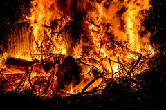 Sparks and tongues of fire on branches and trunks burning in a b. Ig bonfire Stock Images