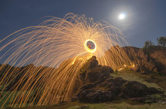 Sparks under full moon Royalty Free Stock Photo