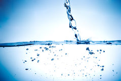 Sparks of water. On white background Royalty Free Stock Photo