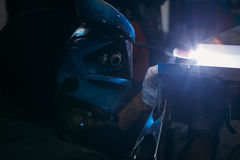 Sparks while welder uses torch to welding. In gloves Royalty Free Stock Images