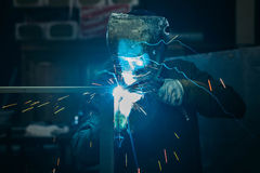 Sparks while welder uses torch to welding. In gloves Stock Photography