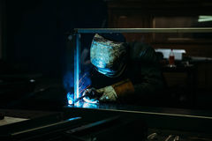 Sparks while welder uses torch to welding. In gloves Stock Images