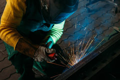 Sparks while welder uses torch to welding. Industry Royalty Free Stock Images