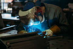 Sparks while welder uses torch to welding. Industry Stock Photos