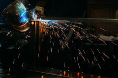 Sparks while welder uses torch to welding. Industry Stock Photography