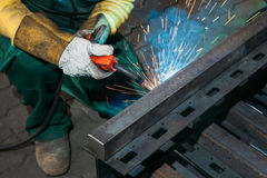 Sparks while welder uses torch to welding. Industry Stock Image