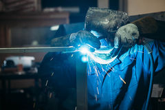 Sparks while welder uses torch to welding. Industry Royalty Free Stock Photos