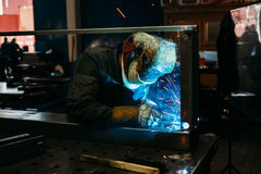 Sparks while welder uses torch to welding. Industry Royalty Free Stock Photo