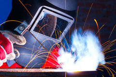 Sparks while welding Stock Photo
