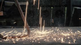 Sparks of welding falling on the floor. Close up of welding`s sparks falling on the floor stock video footage