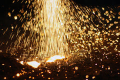 Sparks welding. Working gas welder - fireworks from a variety of falling sparks. Splashes of hot metal royalty free stock photo