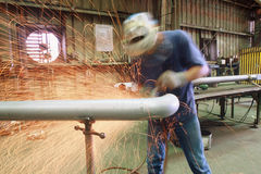 Sparky. Sparks flying from a man grinding on metal stock photo