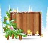 sparrentak met sterren en kaarsen rond vierkante houten grens op de wintervorst lndscape Royalty-vrije Stock Afbeelding