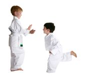 Sparring Partners in Karate. Martial arts sparring parternes.  Over white.  Clipping path Royalty Free Stock Image
