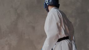 Sparring or single duels in taekwondo class. Pupils kicking in a fighting stance. Forceful attack and defense tactics
