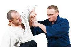 Sparring of two jujitsu fighters stock images