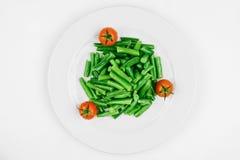 Sparris med körsbärsröda tomater Fotografering för Bildbyråer