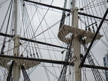 Spars and shrouds of a historical classic frigate ship holding rigging and rope for sailing royalty free stock images