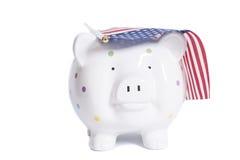 Sparschwein mit amerikanischer Flagge Stockbilder