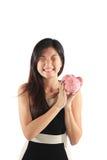 Sparschwein mit Geschäftsfrau stockfoto