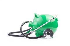 Sparschwein mit Stethoskop Lizenzfreies Stockbild
