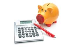 Sparschwein mit Taschenrechner Lizenzfreies Stockbild