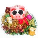Sparschwein mit Weihnachtsdekoration stockfotografie
