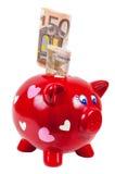Sparschwein und 50 Eurobanknoten Lizenzfreies Stockfoto