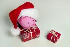 Sparschwein-Weihnachten für Ihre großen Kaufgeschenke lizenzfreies stockbild