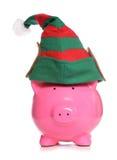Sparschweinweihnachtselfe Stockfoto