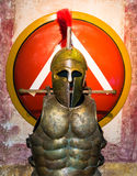 Spartan helmet, armor and shield. Spartan helmet, armor and a red shield Royalty Free Stock Photo