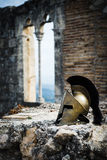 Spartan helmet on castle ruins. Royalty Free Stock Photos