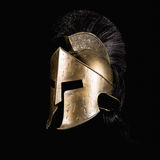 Spartan Helmet. Fiction spartan helmet on black background Royalty Free Stock Photos