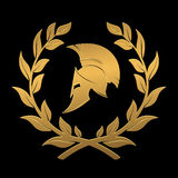 Spartan helmet in a laurel wreath from gold. On the image presented Spartan helmet in a laurel wreath from gold Royalty Free Stock Photos