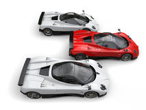 Spartan red super car in front of white super cars - top side view Royalty Free Stock Image