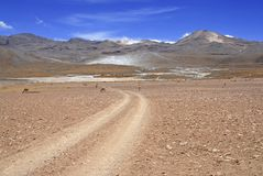 Spartan volcanic landscape of the Atacama Desert. An arid and remote high plateau of rock, mountains and sand in Chile near the Bolivia border, South America stock images