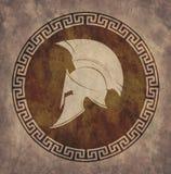Spartanischer Sturzhelm eine Ikone auf altem Papier im Artschmutz, wird in der antiken griechischen Art herausgegeben Stockfoto