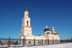 Spaso-Preobrazhensky Cathedral in the city of Nevyansk, bell tower and the leaning tower. Winter cityscape.  Royalty Free Stock Photo