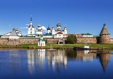 Spaso-Preobrazhensky the Solovetsky Stavropegial monastery with worship the cross in the bay of Well-being on the Bolshoy Solovets. Ky island in the White sea stock photos