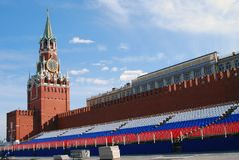 Spasskaya clock tower and holiday tribune Royalty Free Stock Image