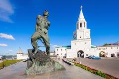 The Spasskaya Saviors Tower. KAZAN, RUSSIA - JUNE 30, 2016: Musa Mostafa Dzhalil Monument and Spasskaya (Savior's) Tower, Kazan Kremlin in Russia. Spasskaya royalty free stock images