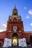 Spasskaya tower, chimes and a passage to the Kremlin against the blue sky at sunset of a sunny day in late autumn. Red Square. royalty free stock photo