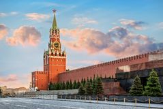 The Spasskaya Tower of Moscow Kremlin. The Spasskaya Tower of the Moscow Kremlin on Red Square, illuminated by the rays of the setting sun of summer stock photo