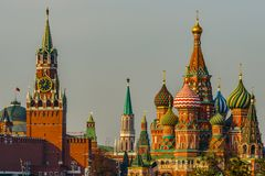 Spasskaya tower of Moscow Kremlin and Saint Basil's cathedral stock photo