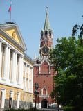 Spasskaya tower and the Senate Palace. On a Sunny summer day in the lush greenery of tree leaves Royalty Free Stock Images