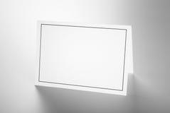 Spatie gevouwen kaart met zwart kader Stock Foto's