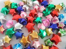 Spatkling colourful stars on white background Stock Photography