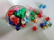 Spatkling colourful stars on white background Stock Photo